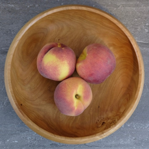 Black cherry bowl with peaches