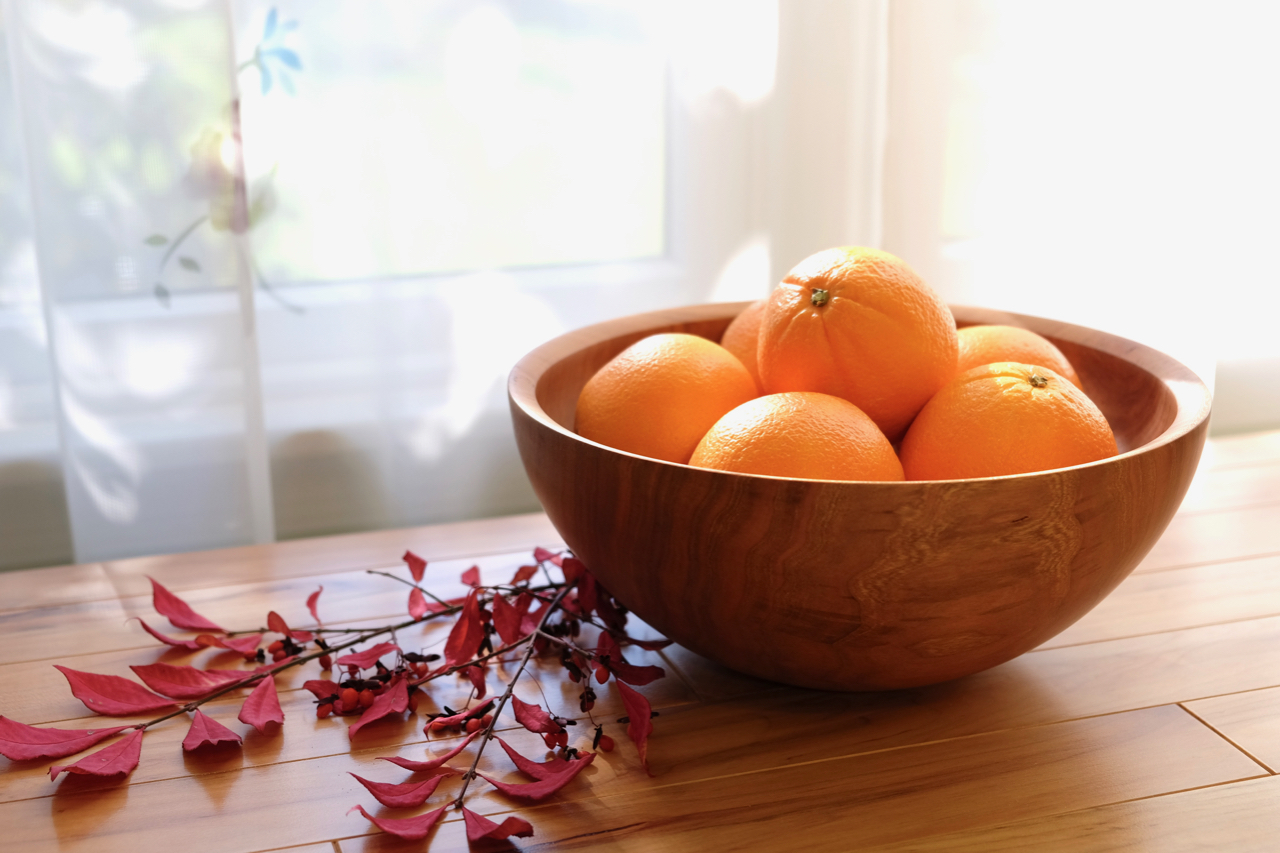 Cherry bowl with oranges